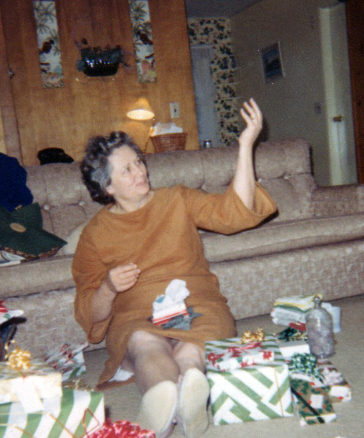 Mother opens a Christmas Gift